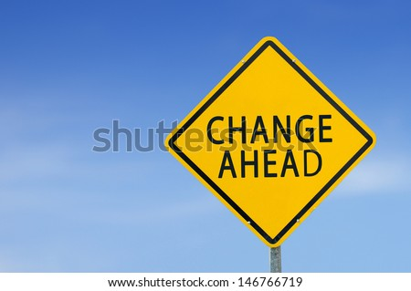 """Yellow traffic sign """"CHANGE AHEAD"""" on the sky background - stock photo"""
