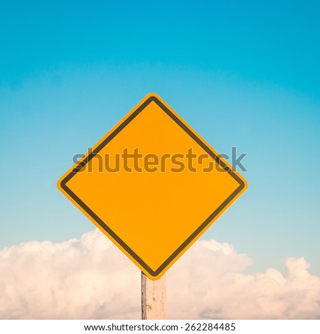Yellow traffic sign on blue sky  - stock photo
