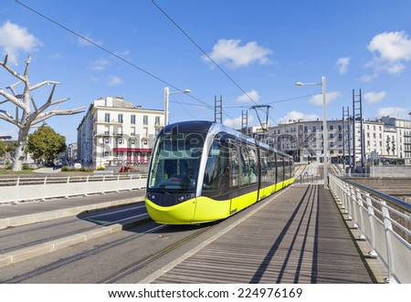 Yellow tram an the street of Brest, Brittany, France - stock photo