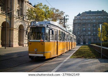 Yellow tram of Budapest at an empty square. Famous tramline number 2. - stock photo