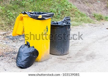 Yellow trash on the street. - stock photo