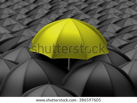 Yellow umbrella above black umbrellas - stock photo