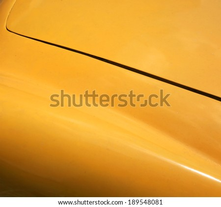 Yellow vintage car hood detail - stock photo
