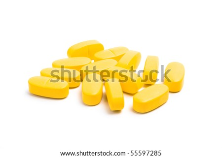 yellow vitamin pills isolated on white background - stock photo