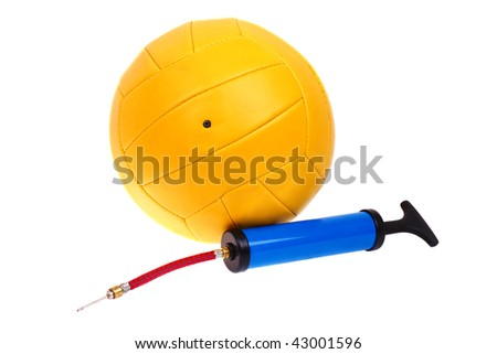 Yellow volleyball and pump with a needle to inflate the balls. White background. - stock photo