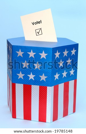 Yellow voting card half-inserted into ballot box decorated with american flag star and stripe colors over blue background - stock photo