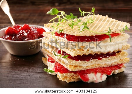 Yellow waffle with cottage cheese and jam