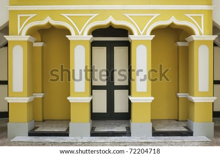 yellow wall and door - stock photo