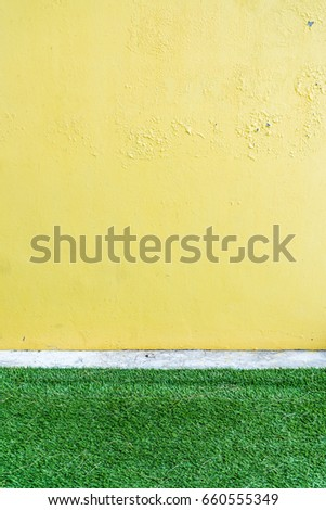 Yellow wall and green grass background