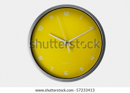 Yellow wall clock isolated with clipping path - stock photo