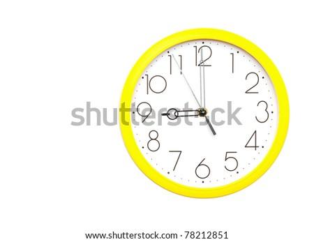 yellow wall clock on white - stock photo