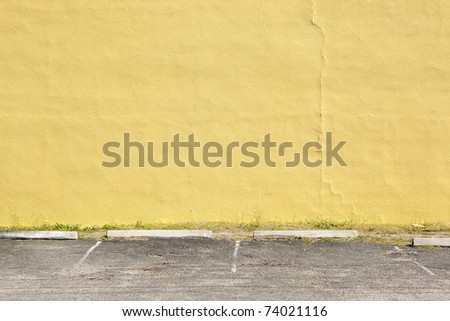 yellow wall parking lot - stock photo