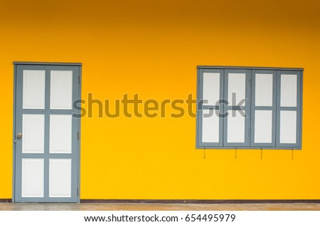Yellow wall with white Door and Window