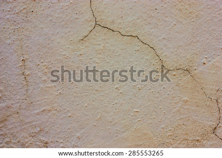 Yellow walls with black surface stains and cracks. - stock photo