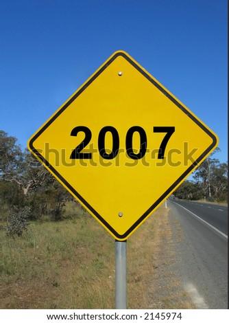 Yellow warning sign - Year 2007 - stock photo