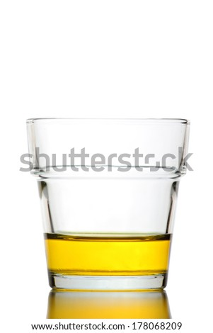 Yellow water in Glass isolated on white background.