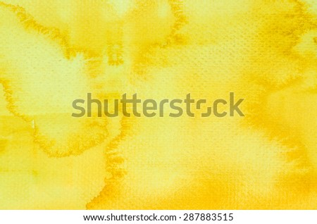 yellow watercolor painting on paper background - stock photo