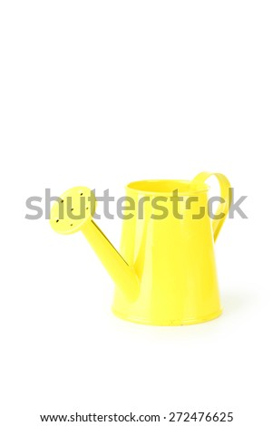 Yellow watering can isolated on white - stock photo