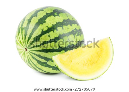 Yellow watermelon with a section on white. - stock photo