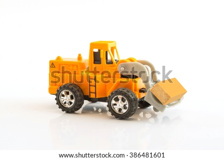 yellow wheel loader toy loading timber isolated on white background,selective focus