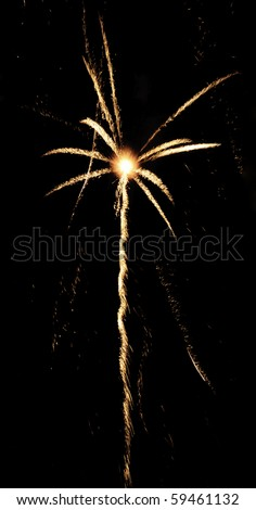 Yellow-white burst of fireworks with rocket trail and white-hot core of explosion - stock photo