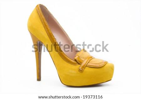 yellow  woman's high heel shoe - stock photo