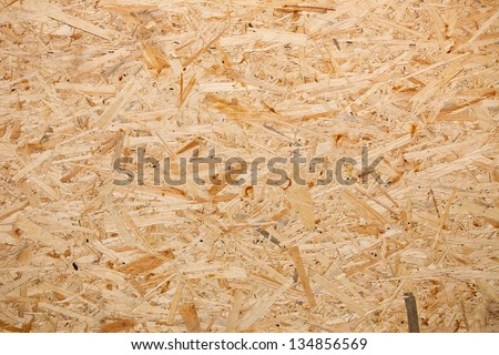 Yellow wood chipboard can be used as a  background - stock photo