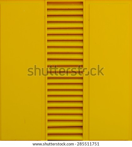 yellow wood door detail or texture - stock photo