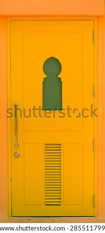 yellow wood door morocco style - stock photo