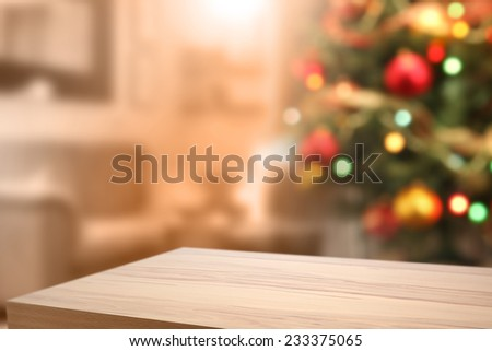 yellow wooden desk space and tree of green with lights  - stock photo