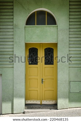 Yellow Wooden Door in a Stone Entry with Arc, Prague, The Czech Republic - stock photo