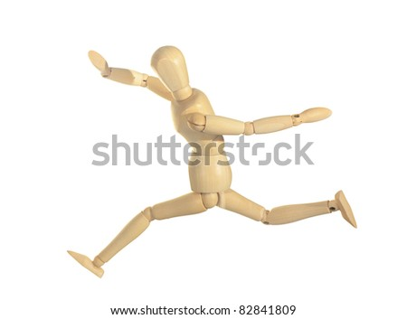 Yellow wooden dummy in run and jump action isolated on white background