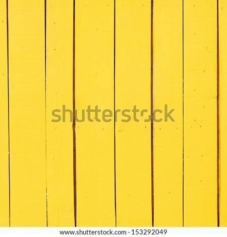 yellow wooden plank as a background or texture - stock photo