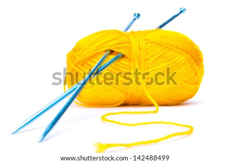 Yellow wool and blue needles - stock photo