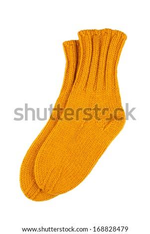 Yellow wool socks isolated on white - stock photo