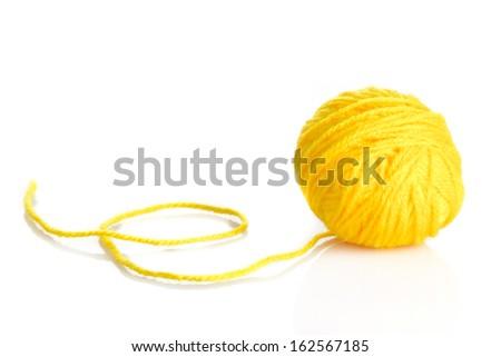 Yellow wool yarn ball isolated on white background - stock photo