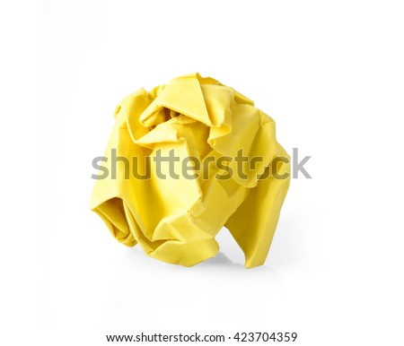 Yellow wrinkled paper ball isolated on white background, symbol of recycling and wasting our resources.  - stock photo