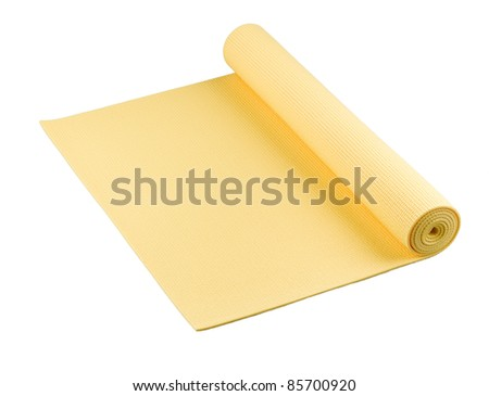 Yellow yoga mat nice for exercise at home or gym - stock photo