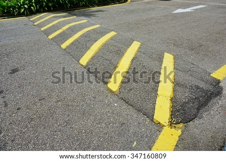 Yellow zebra line on road