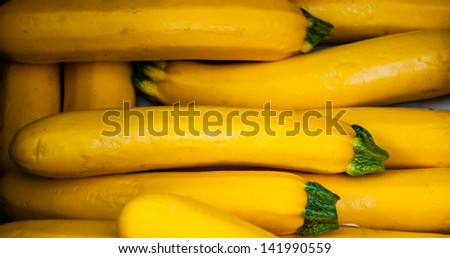 Yellow zucchini at farmers market in Provence. - stock photo