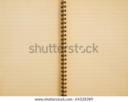 Yellowed paper of spiral notebook