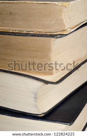 yellowing antique books vertical - stock photo