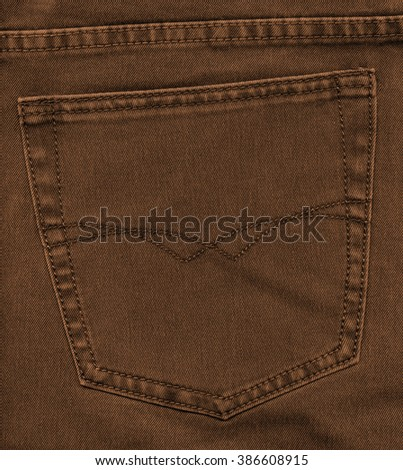 yellowish-brown jeans back pocket