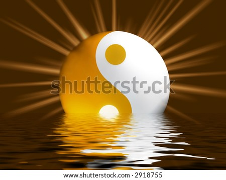 Yellowish Yin Yang Symbol with shiny raylight - stock photo
