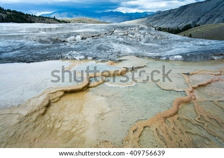 Yellowstone National Park - Geothermal features heat up as storm clouds approach Mammoth Hot Springs in Wyoming. - stock photo