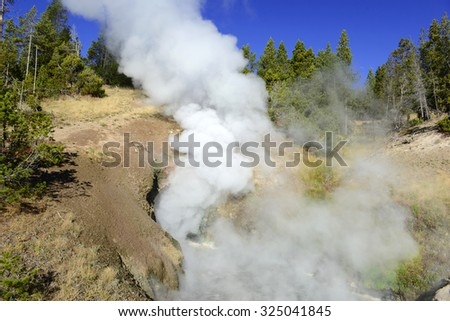 Yellowstone National Park is a volcanically active area, filled with geothermal activity of steam vents, hot springs and geysers - stock photo
