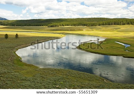 Yellowstone River flowing calmly through Hayden Valley - stock photo