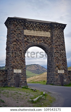 """Yellowstone Stone Entrance Gate - Northern Entrance. \""""For The Benefit And Enjoyment of the People\"""" - Yellowstone National Park. - stock photo"""