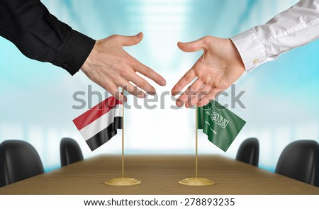 Yemen and Saudi Arabia diplomats agreeing on a deal - stock photo