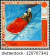 "YEMEN ARAB REPUBLIC - CIRCA 1972: A stamp printed in Yemen from the "" XI Olympic Winter Games, Sapporo"" issue shows bobsleigh, circa 1972. - stock photo"